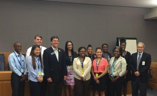 State Senator P.K. Martin meets with students and Judge Joe Iannazzone from the Gwinnett S.M.I.L.E. program to discuss the legislative process on June 10.