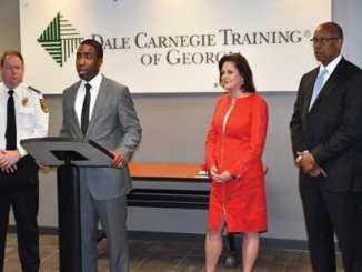 DeKalb Interim CEO Lee May discusses recent training received by the Police Department's command staff, as DeKalb County Police Chief James Conroy, Dale Carnegie Training of Georgia CEO Wendy Johnson and Deputy COO for Public Safety Cedric Alexander look on.
