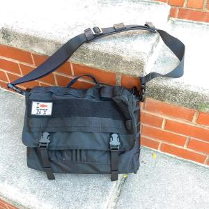 The classic black messenger style briefcase takes a functional tacticalhellip