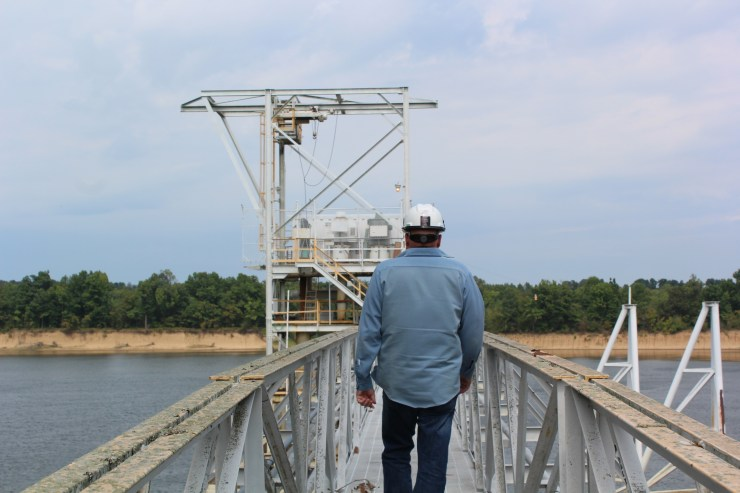 A worker on the water intake structure used by Ashland Manufacturing. The company had to halt production when the river level fell.