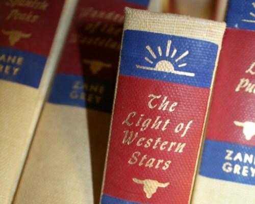 vintage book wedding invitations 500x400 Kristy + Adams Vintage Book Invitations