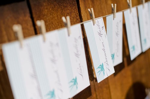 Rustic Blue White Wedding Escort Cards 500x332 Amber + Seans Rustic Wedding Invitations