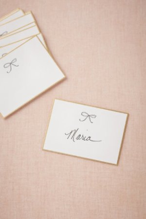 Gold Bow Tie Place Cards BHLDN 300x450 Wedding Stationery Inspiration: Silver + Gold