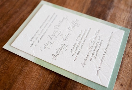 Modern Watercolor Letterpress Wedding Invitations Make Merry 550x377 Anthony + Caseys Nature Inspired Watercolor Wedding Invitations