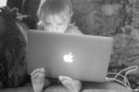 Little girl on computer