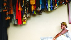 Kevine Kagirimpundu, one of this year's featured designers at the JEWEL Fashion Show sits next to some of her products.