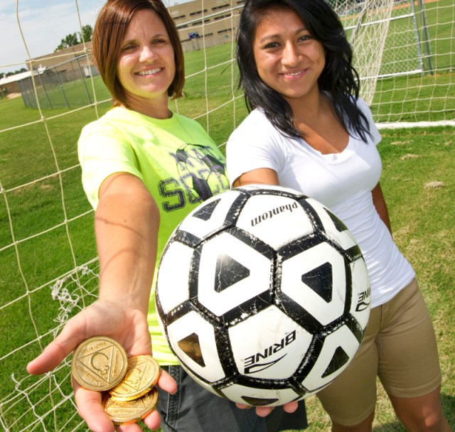 Left, NW Classen Coach Cindi George with The Elevate Character gold medal award and student athlete Yasmi Lopez 16, a sophmore. Yasmi (pronounced Jasmi) won the award last year in soccer for Courage. (Shannon Cornman)