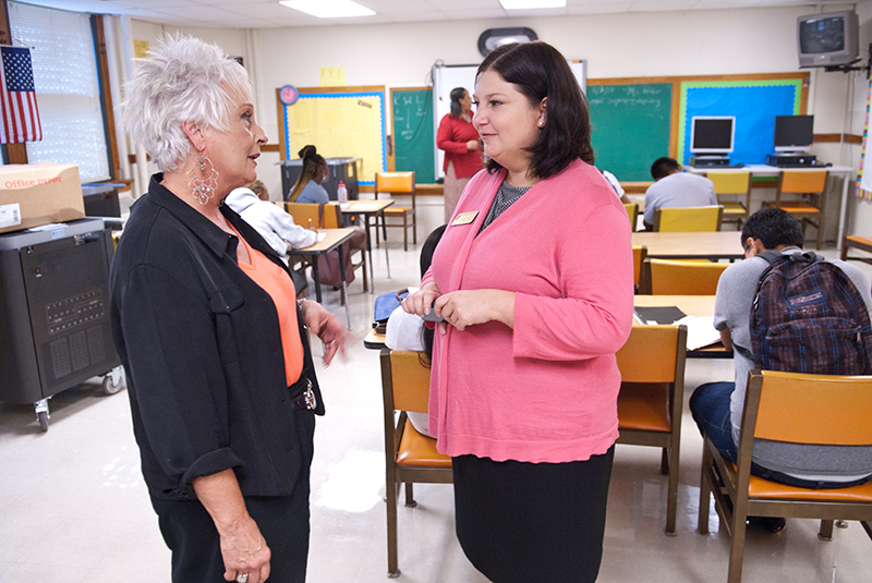 Aurora Lora, right, meets with Emerson Alternative School's principal, Sherry Kishore, in one of the classrooms. (Mark Hancock)