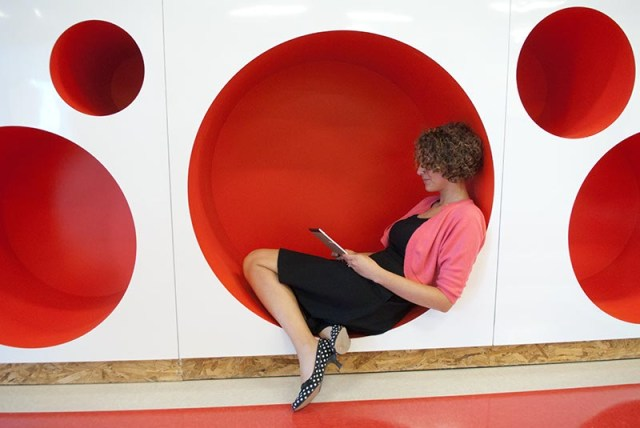 Karin Rowe, a Kindergarten teacher, demonstrates the circular reading spaces, at the new John Rex School.  (Mark Hancock)