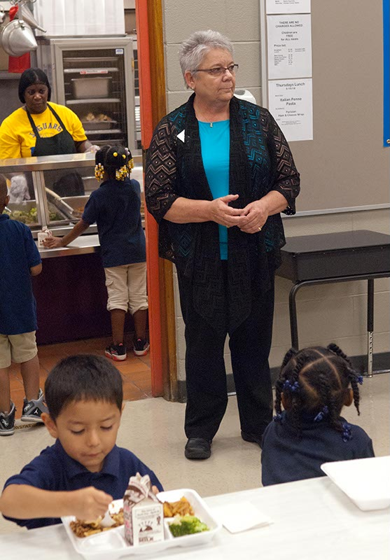 Principal Mary Coughlin watches over the lunchroom at Spencer Elementary as the students have their first Free Lunch. (Mark Hancock)