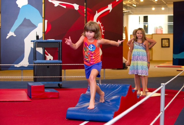 Riley Ann Taylor runs the Obstacle Course at Science Museum Oklahoma while her sister Alexandra anxiously waits her turn. (Shannon Cornman)