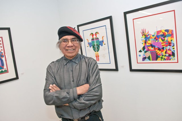 Benjamin Harjo Jr. with his art. (Mark Hancock)