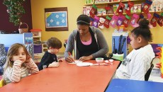Sydney Lane works with children in a classroom at Special Care, Inc.  mh