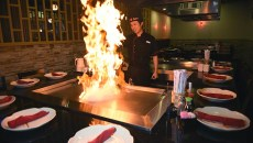 Hibachi chef Demon Tian fires up the grill at Sake House.  mh