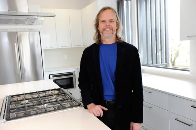 Architect and interior designer Ken Fitzsimmons inside the kitchen of 828 Residence, a project he helped with.  (Home featured on this week's cover) (Garett Fisbeck)