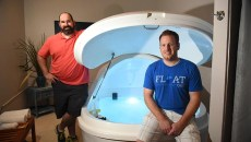 From left, Matt Ligon and Neal Smock with one of three sensory deprivation chambers their company, Float OKC has in operation.  mh