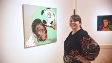 Bonita James, media relations with OKCMOA, with works by Andy Warhol, part of The Athletes exhibit recently.  mh