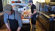 Left to right, Alex Moyer, cook, and Jonathan Stranger, owner, chef, work on food mid-day before their evening diner time opening, Monday, 9-21-15.  (Mark Hancock)