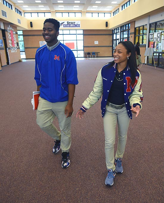 <em>From left,</em> Senior Class President E.J. Green walks with college scholarship recipient Breonna Hall. (Mark Hancock)