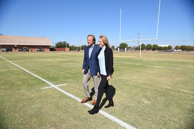 Tim and Liz McLaughlin walk along a Fields & Futures Foundation project at Webster Middle School in Oklahoma City. (Mark Hancock)