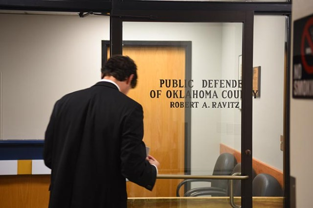 An attorney looks over paperwork before he enters the Oklahoma County Public Defender's Office. (Mark Hancock)