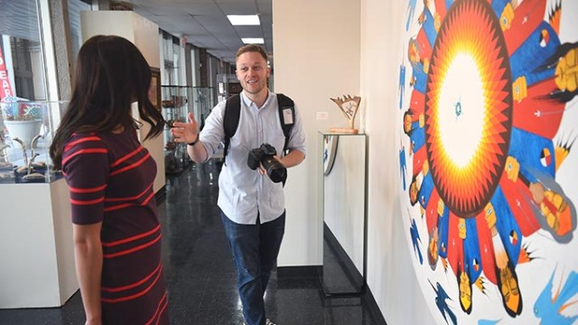 Caleb Everett is the new multimedia content manager at the OKC Convention & Visitors Bureau, shown working with his wife, Sarah Everett he is using as a model while photographing artwork to compliment video already shot at the Red Earth Museum in Downtown Oklahoma City, 1-2-15.  (Mark Hancock)