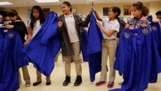 Students in the Honor Choir pass out new robes at Bodine Elementary in Oklahoma City, Friday, Nov. 6, 2015.  (Garett Fisbeck)