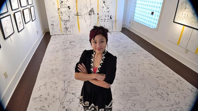 Artist Denise Duong stands in and on her installation at JRB Art at the Elms on North Walker Avenue in Oklahoma City, 12-17-15.  (Mark Hancock)