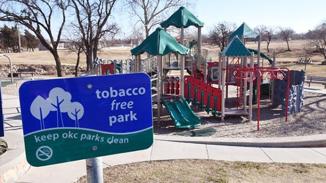 """Existing """"Tobacco Free Park"""" sign at a playground area of Will Rogers Park, off North Portland Avenue in Oklahoma City, 12-23-15.  (Mark Hancock)"""