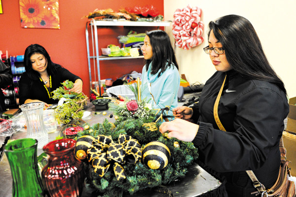 Yessica Oviedo, Jessica Rios and Dalia Rios work in the horticulture class at Metro Career Academy. (Garett Fisbeck)