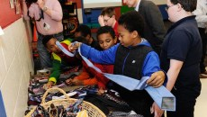 Children pick out ties during Tie Day at Edgemere Elementary in Oklahoma City, Thursday, Jan. 14, 2016.  (Garett Fisbeck)