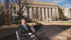 Aubrey Hamontree, Head of theCity of Oklahoma City Planning Department, sits on one of the new park bencheson the east side of City Hall, 1-28-16.  (Mark Hancock)