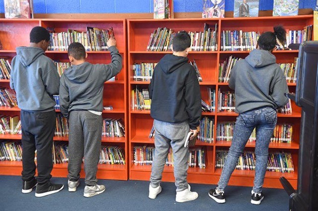 Students browse the library at Justice Alma Wilson SeeWorth Academy's south campus, 3806 N. Prospect Ave. (Mark Hancock)
