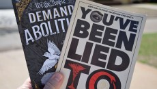 """Abolitionist Society of Oklahoma demonstrators hand out fliers like these to just about anyone who will take them. """"We want information in the hands of people,"""" said co-founder Katherine Hunter. (Brett Dickerson / For Oklahoma Gazette)"""