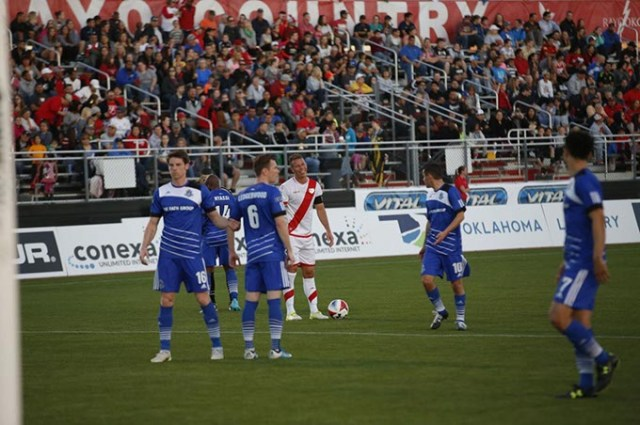 Michel <em>center</em> readies for a kick at Rayo OKC's first match April 2. (Rayo OKC / Provided)