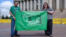 ​William Patrick Jones and Chelsea Marlett-Kennedy, of Oklahomans for Health, pose for a photo at the Oklahoma State Capitol, Thursday, April 14, 2016.  (Garett Fisbeck)
