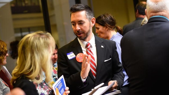 """Andy Moore talks with citizens during a """"Let's Fix This"""" meeting at the Oklahoma State Capitol, Wednesday, April 27, 2016.  (Garett Fisbeck)"""