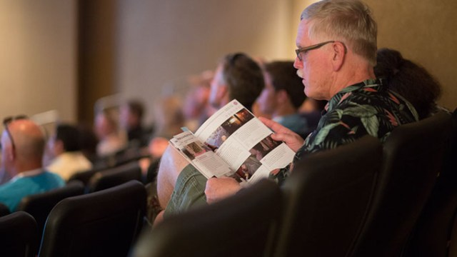 "Larry Hopper reads the Dead Center Film Schedule at the Museum of Art Theatre in Oklahoma City, Saturday, June 11, 2016.  Hopper was in attendance for a showing of ""Tower"".  (Emmy Verdin)"