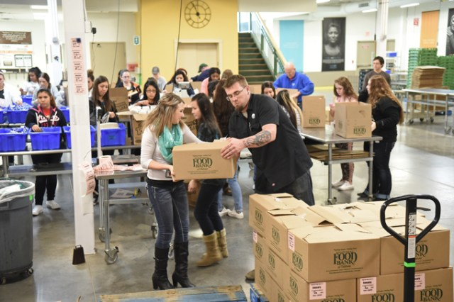 A group donates time packing food for the hungry at Regional Food Bank of Oklahoma. Last year, 34,000 volunteers saved the organization $2.8 million in labor costs. (Gazette / file)