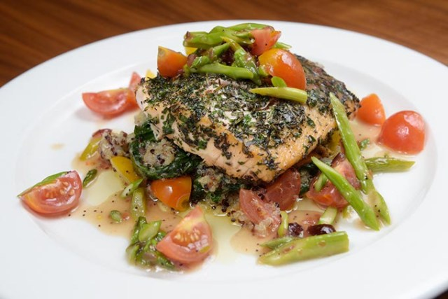 Herb-crusted salmon over sauteed spinach and quinoa (Garett Fisbeck)