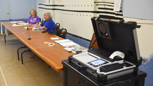 Election officials, left, Eva Welch and Mary Austin, at thier station during the election on 7-14-15 at Crown Heights Church of the Nazarene.  mh
