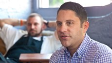 Co-owner Shaun Fiaccone discusses the 5 years he has had Picasso Cafe, with fonding member and chef Ryan Parrott listening in background, recently during an interview.  mh