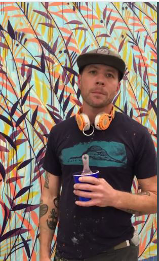 "Artist Jason Pawley in front of his mural ""Full Circle"" (provided)"
