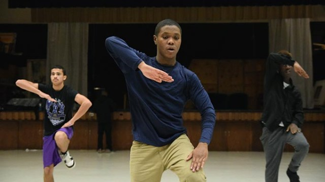 Up front, Deiontay Reed, (GI Joe) performs with Brothers of Stomp during a demonstration of their step routines at Star Spencer High School, 2-6-2017.  (Mark Hancock)