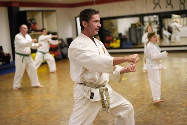 Chris Fay teaches a class at Okinawa Karate School. (Garett Fisbeck)