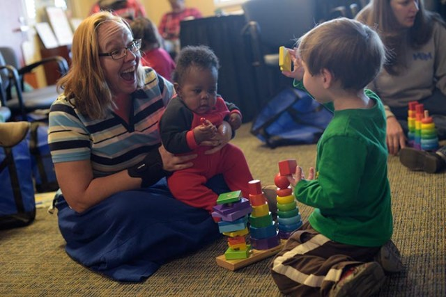 Colleen Wilcox plays with her son Luck, 2, and Elijah during an Early Bird class at Metro Career Academy, Friday, Feb. 3, 2017.  (Garett Fisbeck)