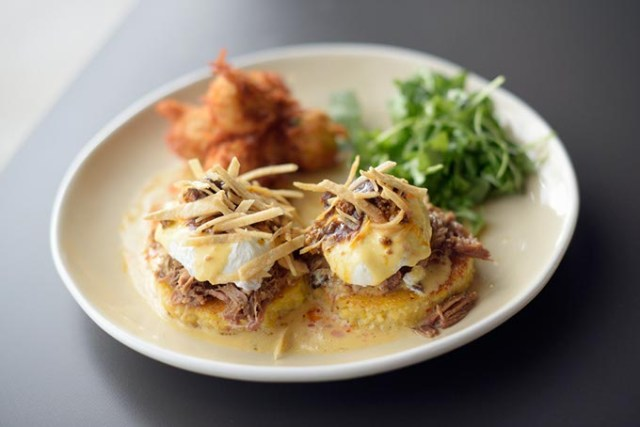 Benedict Johnny: griddled grit cakes with beer-braised pork, poached eggs, chipotle hollandaise and chorizo red chili sauce (Garett Fisbeck)