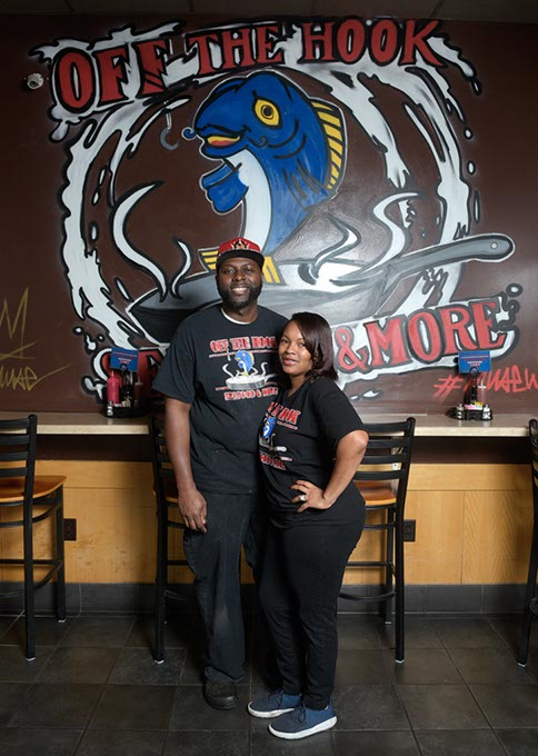 Off the Hook owners from left Corey and Loniesha Harris are working to open a second location of their popular seafood restaurant. (Garett Fisbeck)