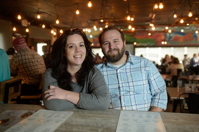 Shannon and Jordan Sipes sit at the bar at Cafe Kacao, the restaurant where they first met on Valentine's Day.  (Garett Fisbeck)