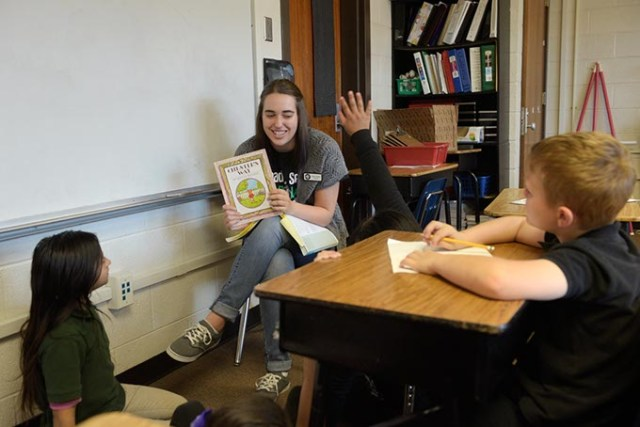 AmeriCorps member Brittny Meeks reads to students during an afterschool program at northwest Oklahoma City's Hilldale Elementary. (Garett Fisbeck)